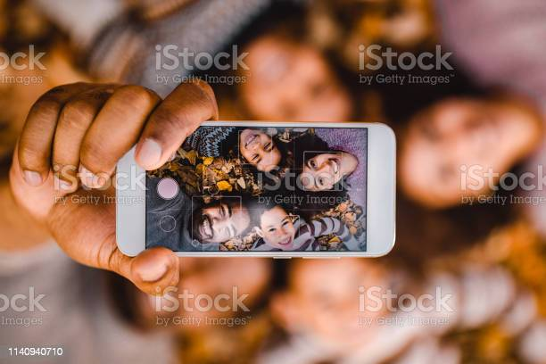 Close up of happy black family taking a selfie with cell phone in picture id1140940710?b=1&k=6&m=1140940710&s=612x612&h=mee2tafvjyyvetosulx0orootw 3xozuiiu6j q5jpq=