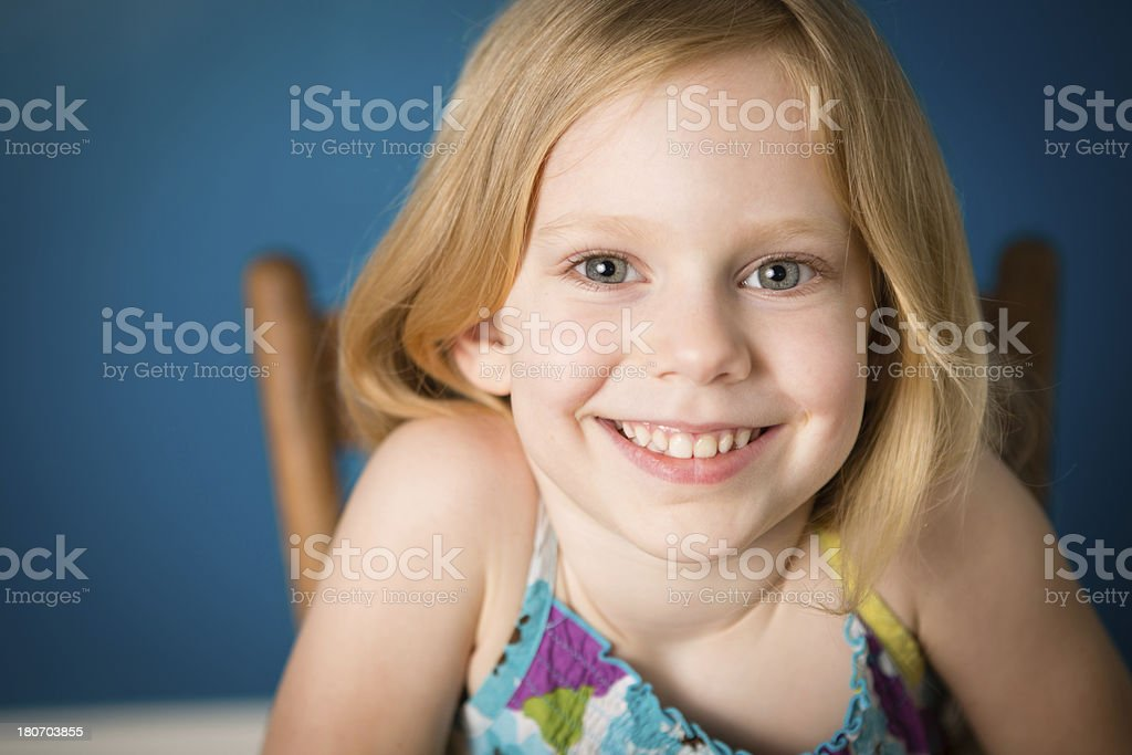 Close Up of Happy, Five Year Old Blond-Haired Girl royalty-free stock photo
