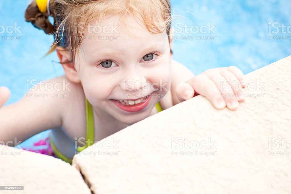 Close Up of Happy, Little Girl in Swimming Pool stock photo