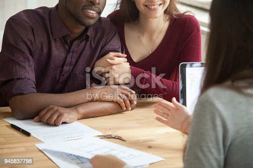 istock Close up of happy multiracial couple buying home 945837798
