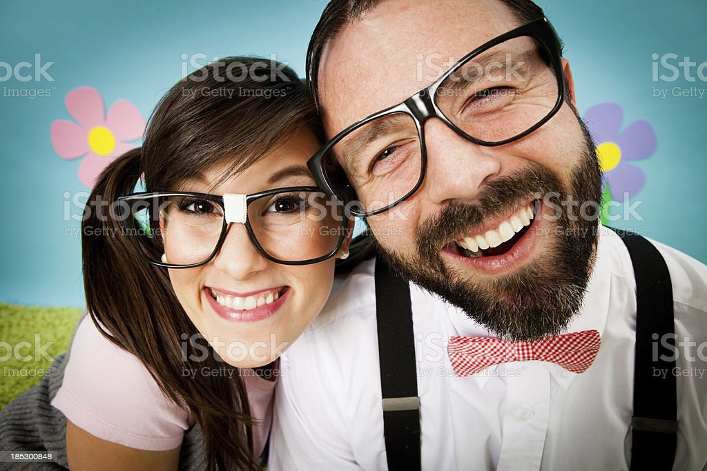 Close Up of Happy Nerd Couple in Whimsical, Outdoor World stock photo