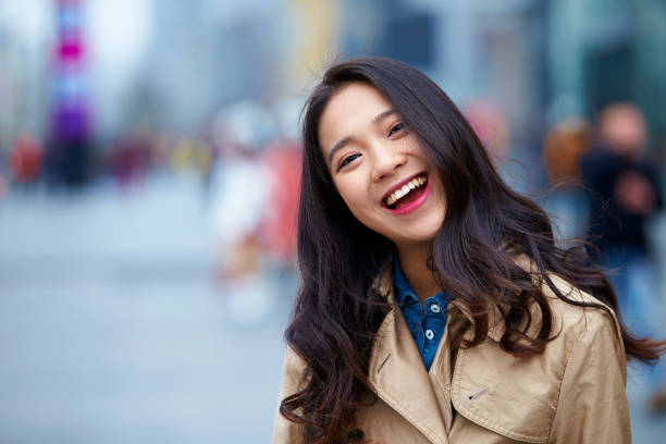 close  up of happy young asian woman stock photo