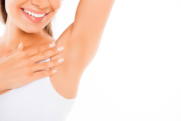 Close up of  happy young woman showing her smooth armpit stock photo