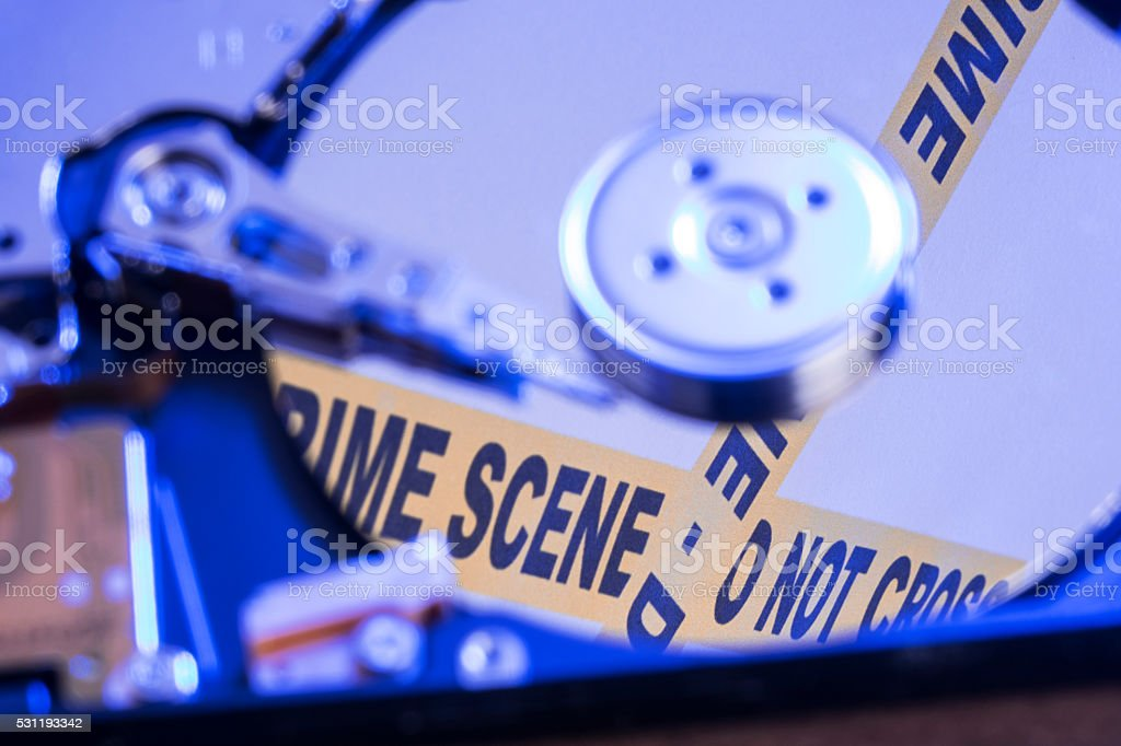 Close Up Of Hard Drive With Crime Scene tape stock photo