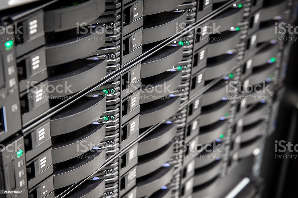 Close up of hard drives in large SAN storage stock photo