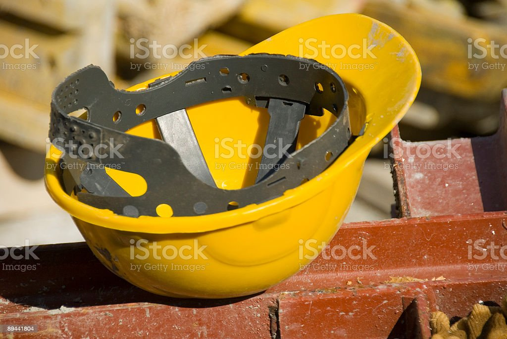 Close up of hard hat at construction site royalty-free stock photo