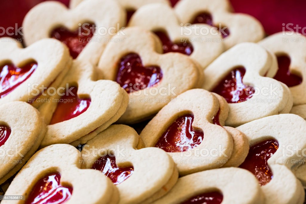 Close up of Heart shaped biscuits in a row stock photo