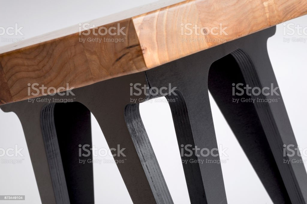 Close up of Hexagonal Coffee Table with Painted Black Legs stock photo