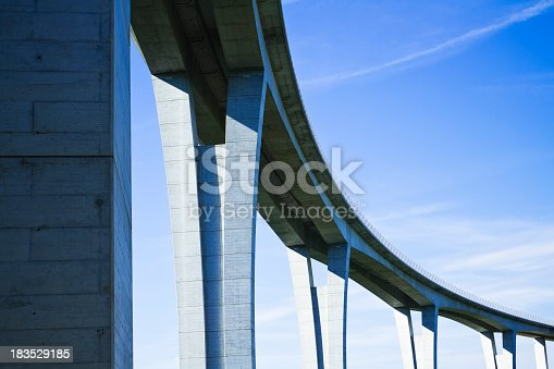 istock Close up of highway viaduct in front of a clear blue sky 183529185