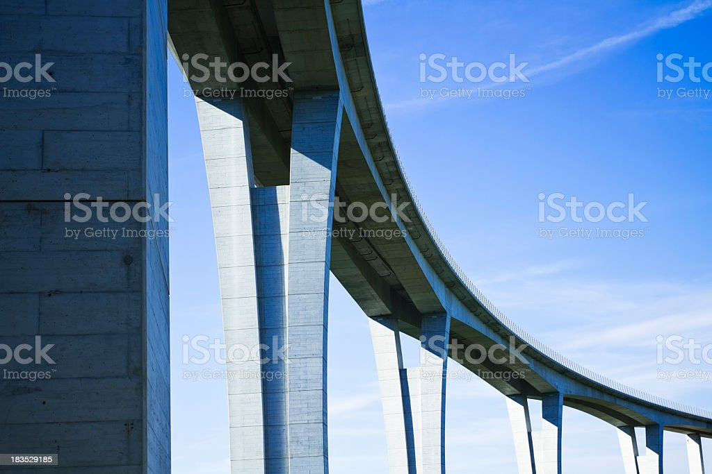Close up of highway viaduct in front of a clear blue sky stok fotoğrafı