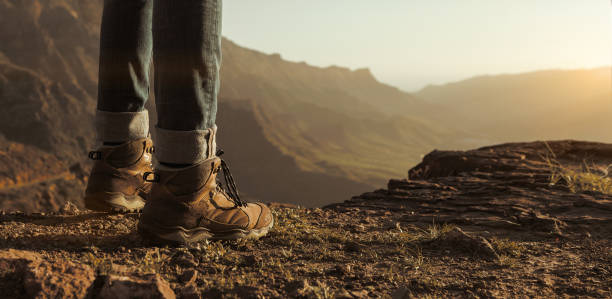 Close up of hikers boots Close up of hikers boots enjoying the sunset on top of the mountain with copy space boot stock pictures, royalty-free photos & images