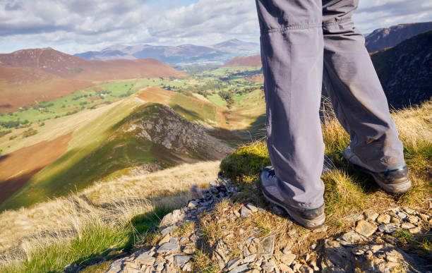 A close up of hikers legs A close up of hikers legs looking down High Snab Bank and Scope Beck in the Lake District, England, UK. walking uk stock pictures, royalty-free photos & images