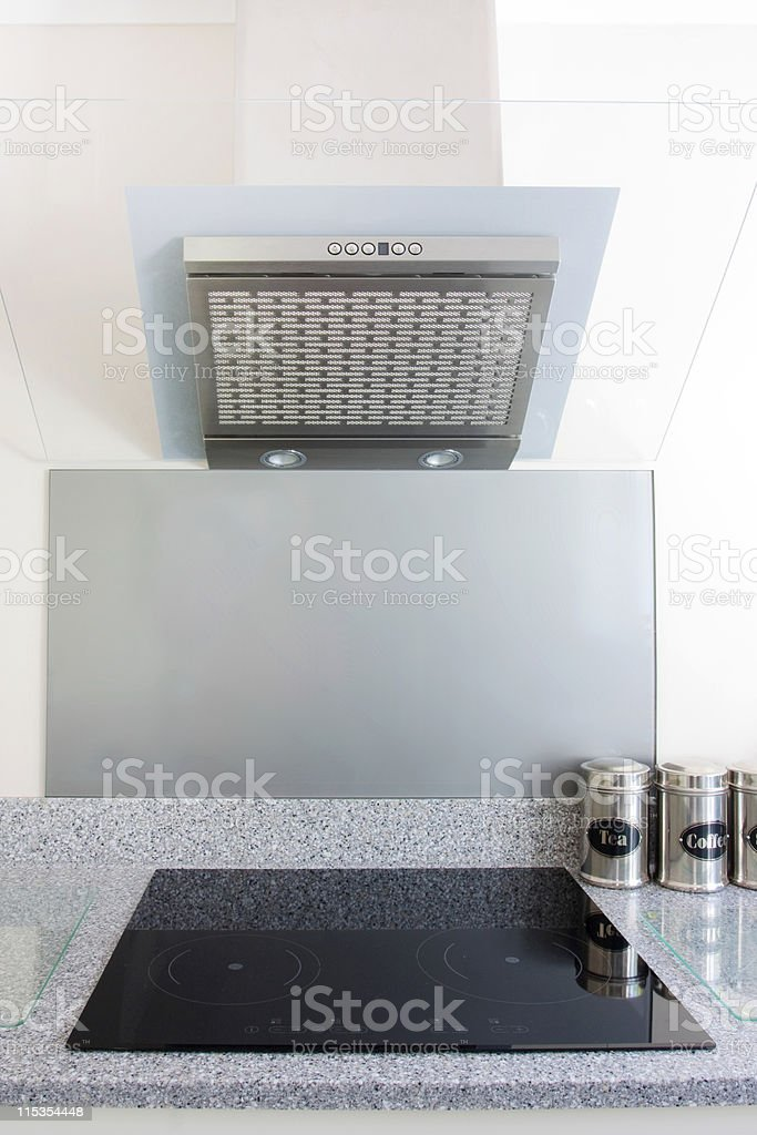 close up of hob and kitchen extrator fan stock photo