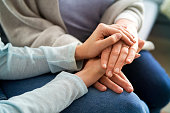 istock Close up of holding hands in a sign of support 1312275144