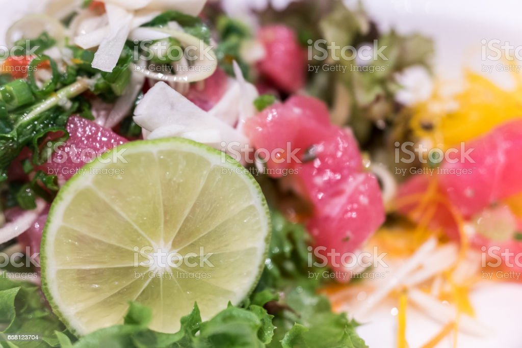 Close up of homemade fresh salad with tuna and salmon stock photo