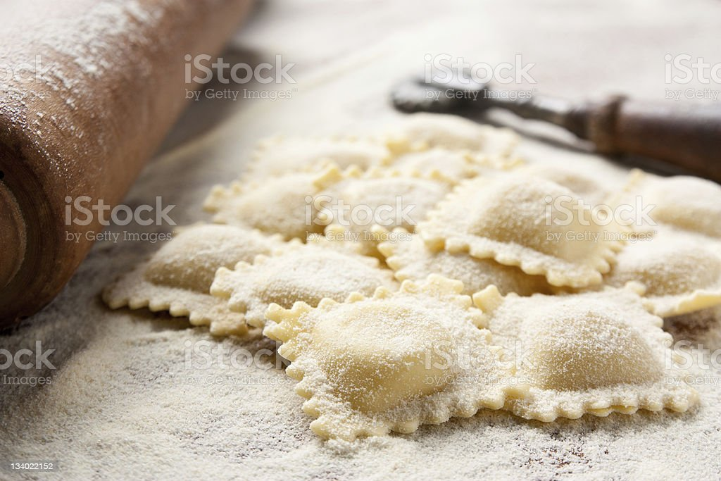 Close up of homemade ravioli and tools stock photo