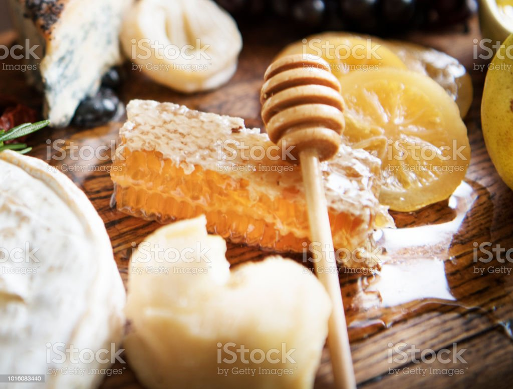 Close up of honey comb on a cheese board stock photo