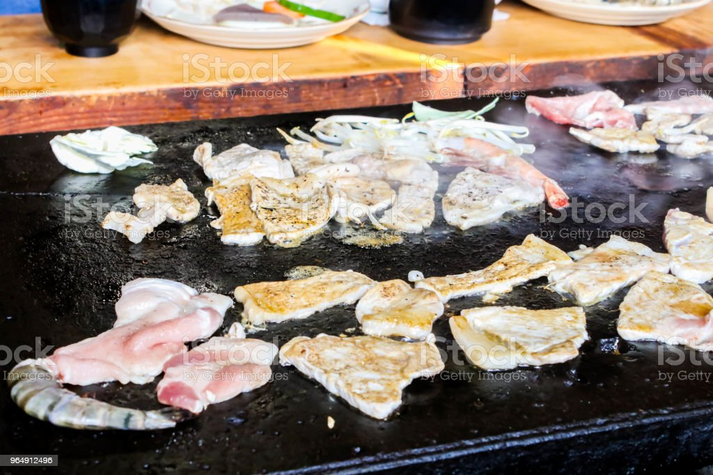 Close up of Hot Traditional pork tepanyaki on hot pan in Japan royalty-free stock photo