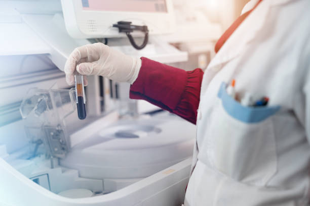 Close up of human biotechnologist testing new chemical substances in a laboratory - Stock photo Close up of human biotechnologist testing new chemical substances in a laboratory - Stock photo stem cell stock pictures, royalty-free photos & images