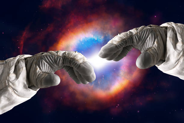 close up of human hands touching with fingers in space. nebula on background. elements of this image furnished by nasa - astronaut stock pictures, royalty-free photos & images