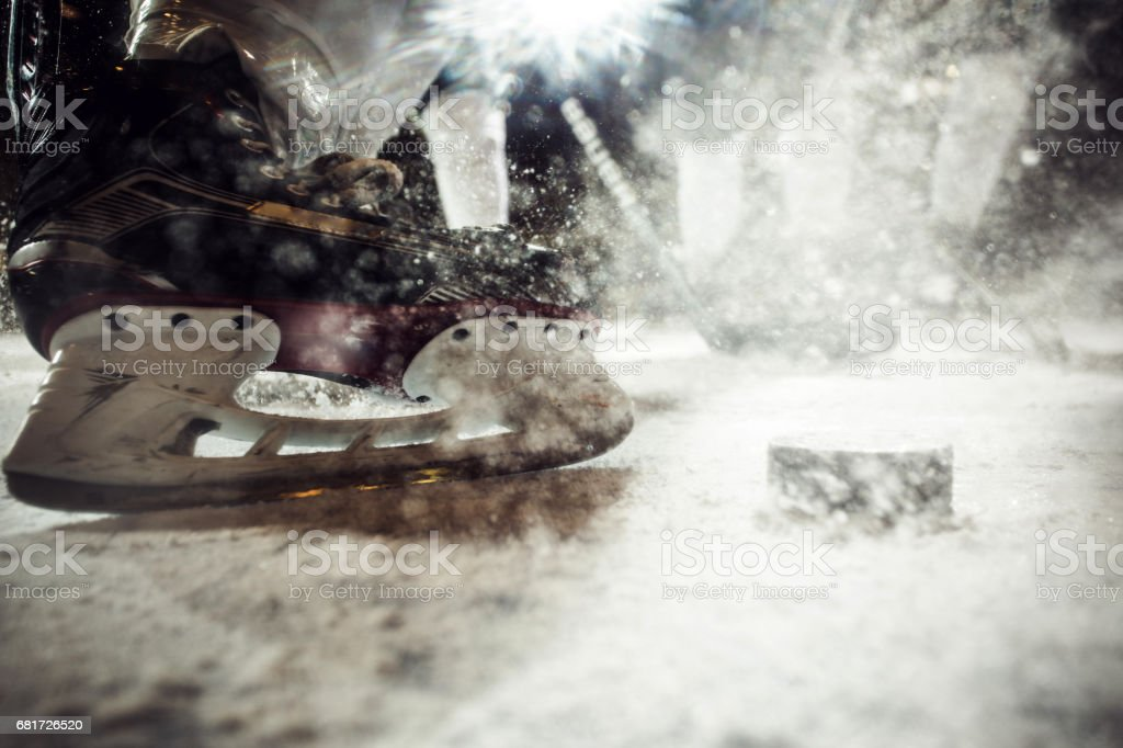 Close up of ice hockey player's skate on ice. stock photo