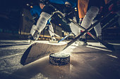 istock Close up of ice hockey puck and stick during a match. 854297640