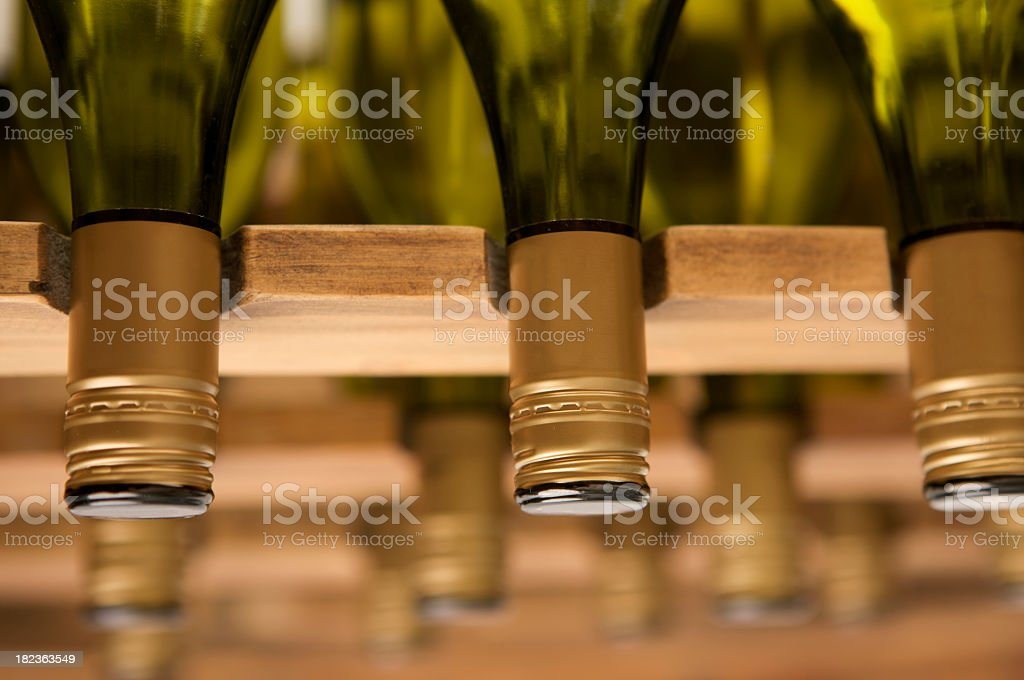 Close up of identical white Wine bottle tops in rack. royalty-free stock photo