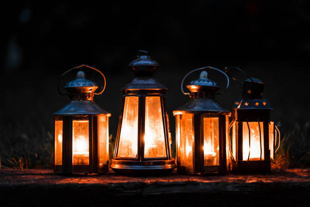Close Up Of Illuminated Antique Lanterns Lit By Candlelight In A Row Stock Photo