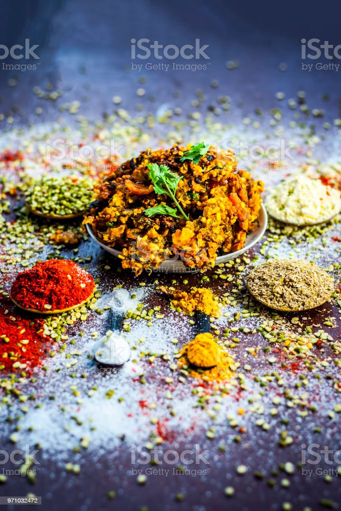 Close up of Indian/Asian popular Ramzan's/Ramadan's special vada/vadiya with all its grams,speices on a wooden surface in dark Gothic colors. stock photo