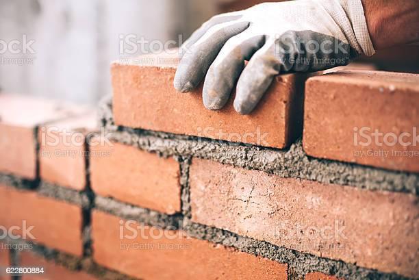 Close up of industrial bricklayer installing bricks on construction picture id622800884?b=1&k=6&m=622800884&s=612x612&h=jclzm sux3jkmlcfl8y44kfsfuk49uu qqaawk8azj0=