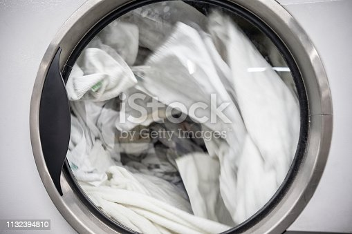 Close up of industrial washing machine at a laundromat - No people