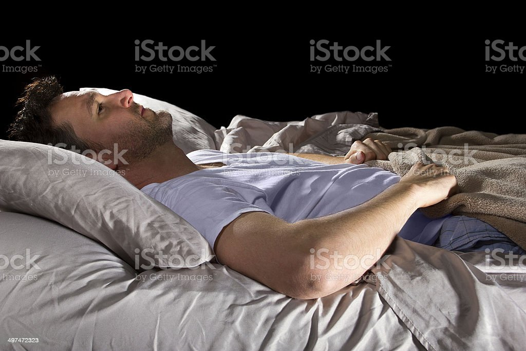 Close Up of Insomniac Unable To Sleep In Bed stock photo