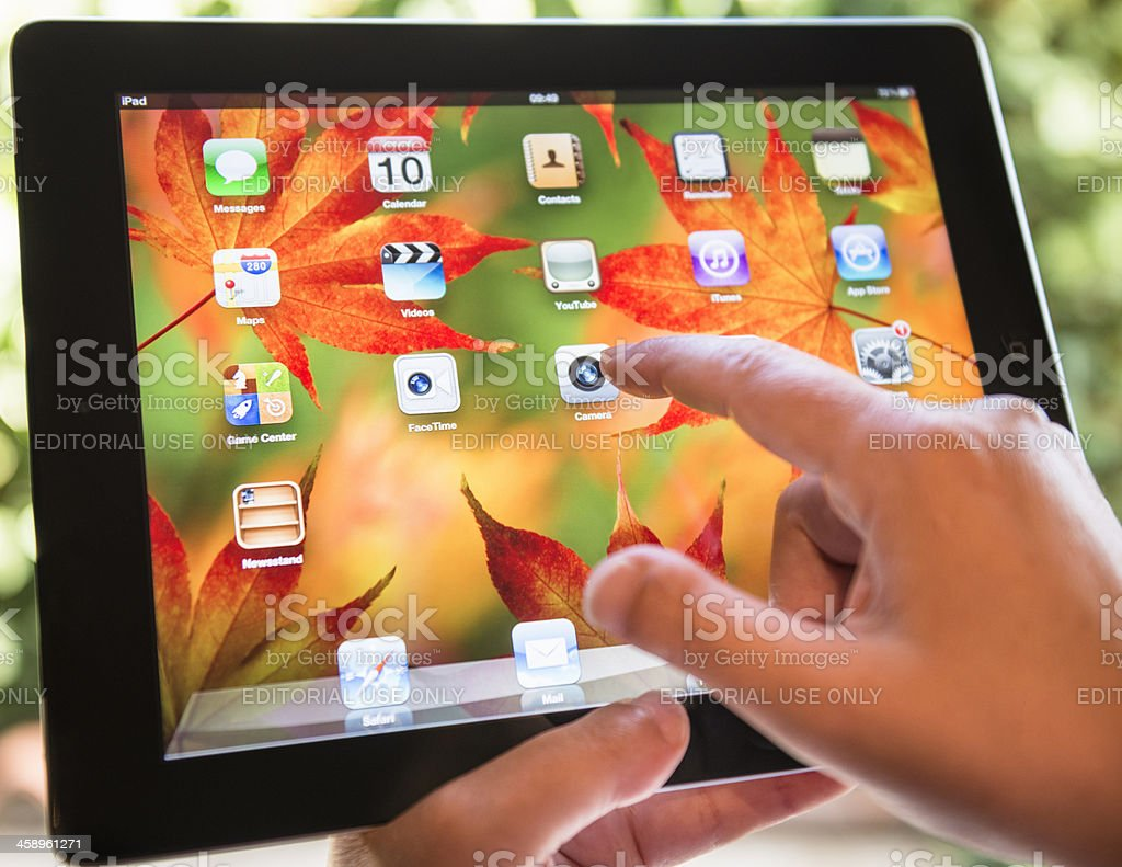 Close up of ipad 3 with autumn background screen stock photo