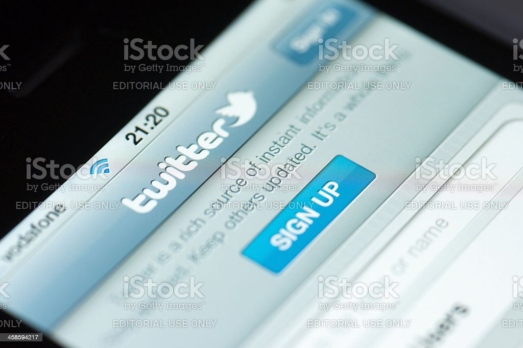 Close up of iPhone 4 screen with Twitter stock photo