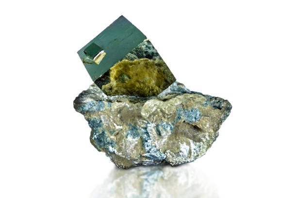 A close up of iron pyrite mineral isolated on dark/white background stock photo