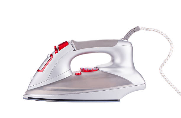 close up of ironing tool. - ironing stock photos and pictures