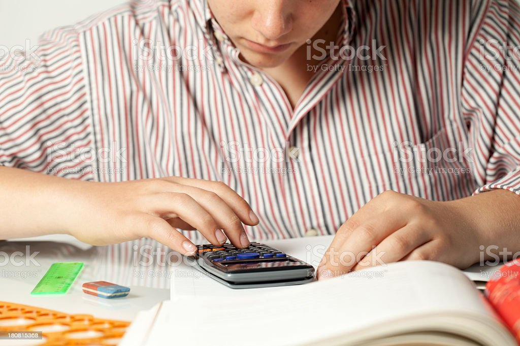 Close Up Of Italian Teenager Using Pocket Calculator royalty-free stock photo