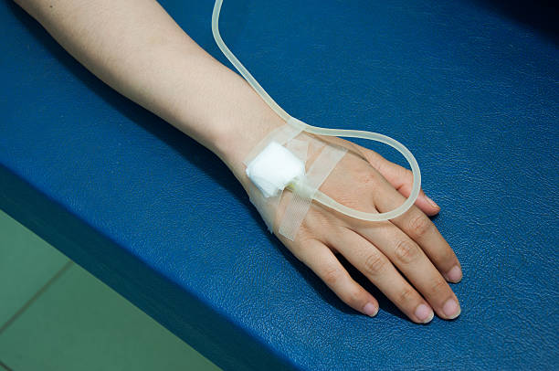 Close up of  iv drip in patient's hand stock photo