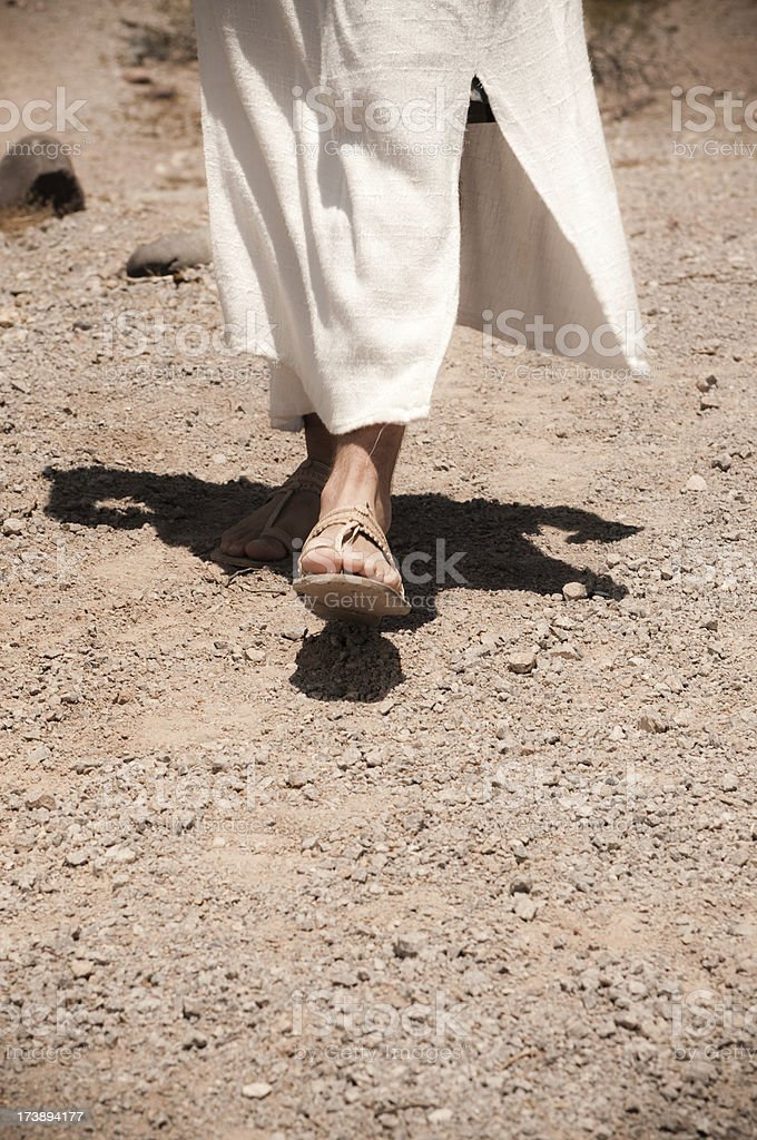 Close up of Jesus walking in the dessert stock photo