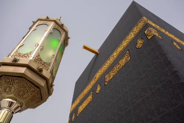 Close up of Kaaba with one of the lights. Low angle view of Kaaba in Mecca, Saudi Arabia. circumambulation stock pictures, royalty-free photos & images