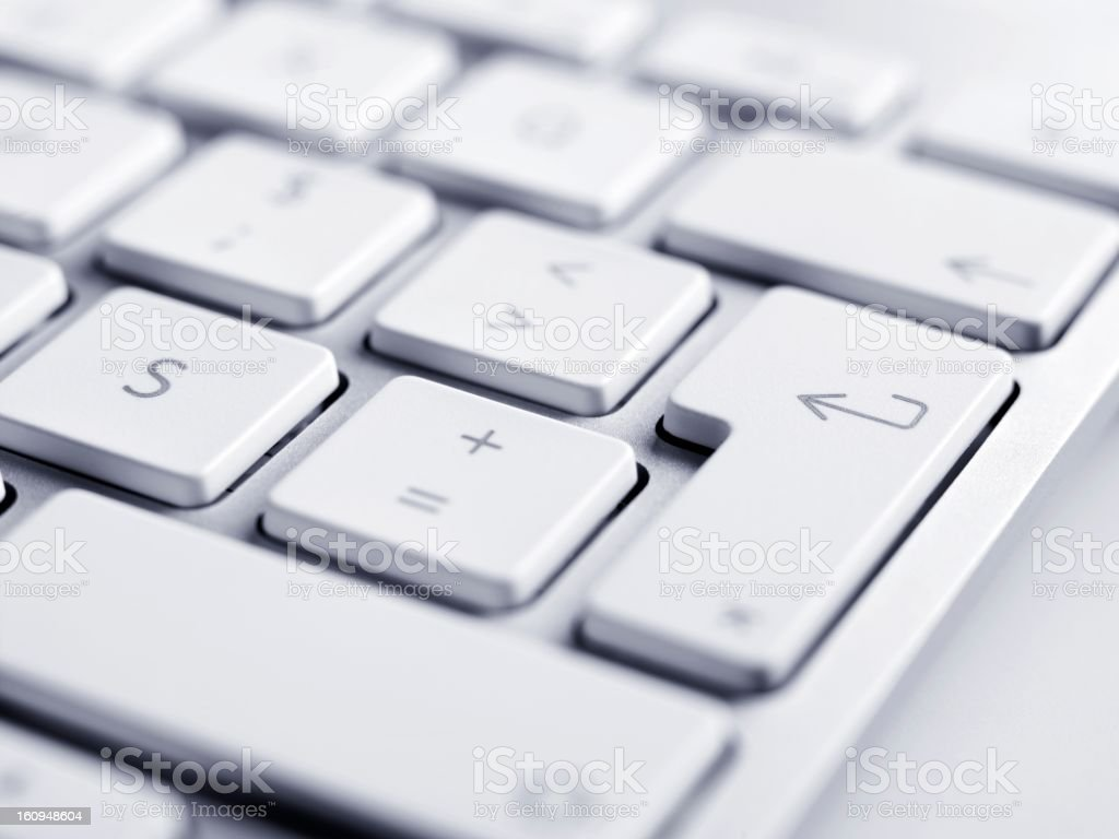 Close up of keyboard, focus on enter button stock photo