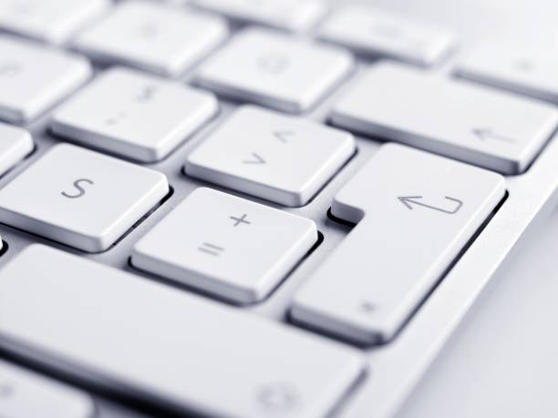Close up of keyboard, focus on enter button close-up shoot of keyboard. enter key stock pictures, royalty-free photos & images