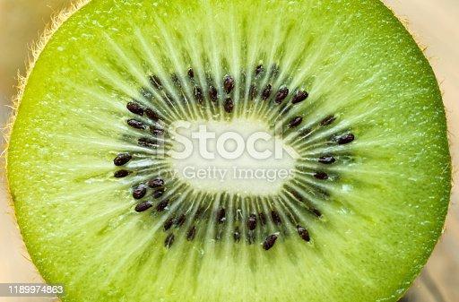 Close up of kiwi fruit slice background.