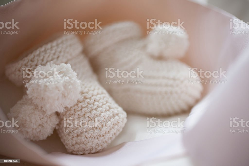 Close up of knit baby booties stock photo