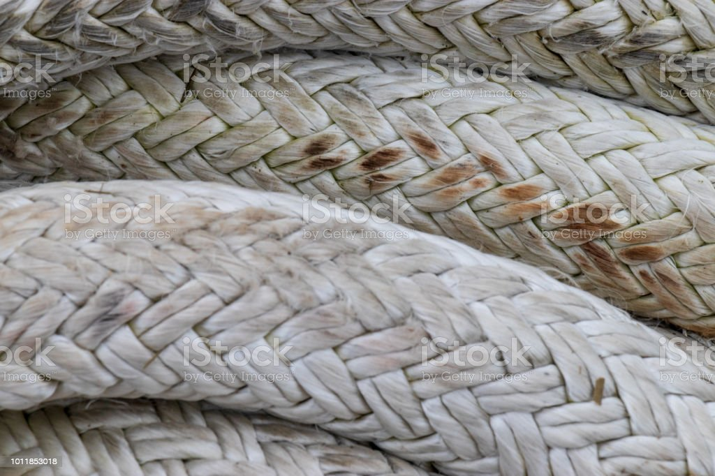 Close up of large braided rope used to secure ships to docks. stock photo