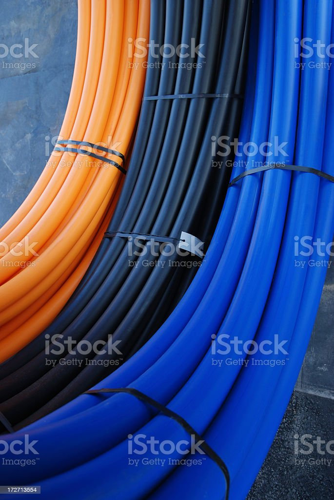 Close up of large rolls of plastic piping stock photo