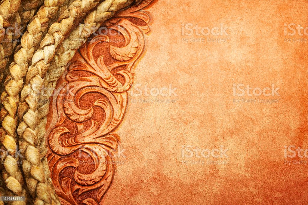 Close Up Of Lasso On A Western Tooled Leather Surface stock photo