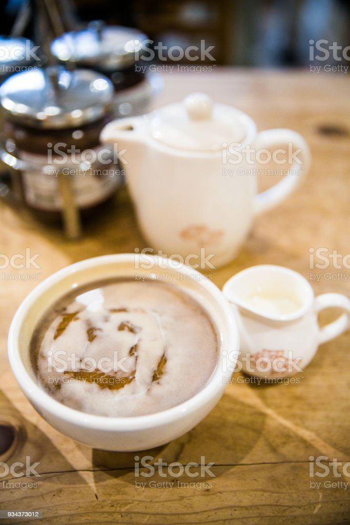 Close up of Latte with milk and creamer stock photo