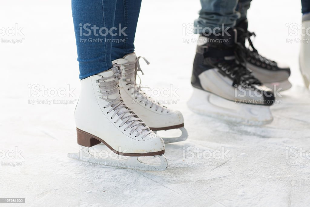 close up of legs in skates on skating rink stock photo