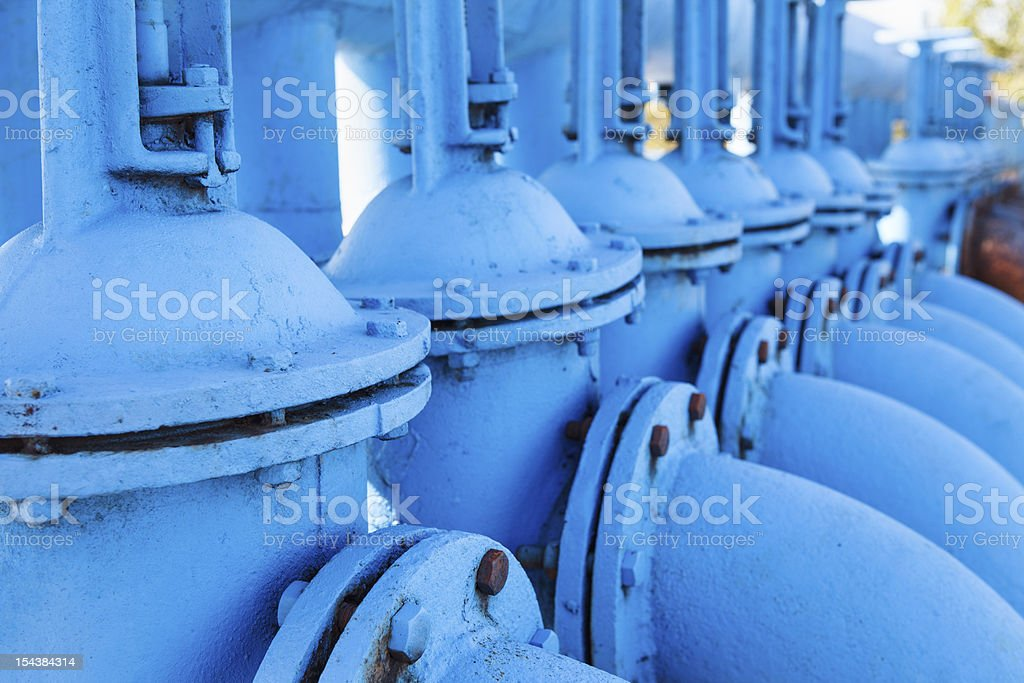 Close up of line from blue oxygen gate valves royalty-free stock photo